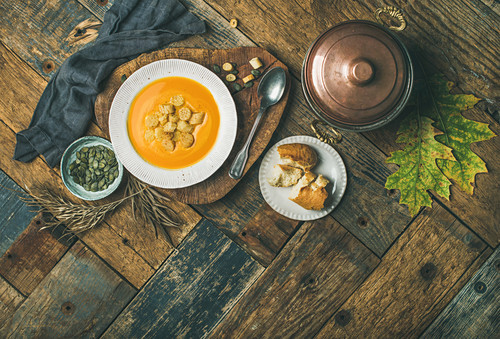 Fall warming pumpkin cream soup with croutons and seed