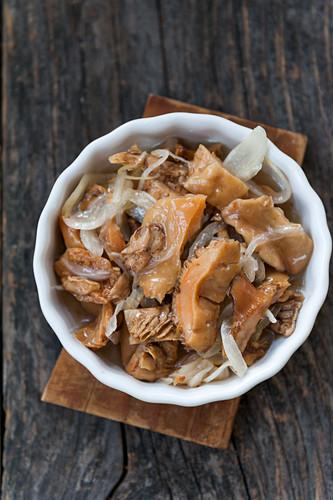 Pickled Lactarius deliciosus mushrooms with onion in a bowl