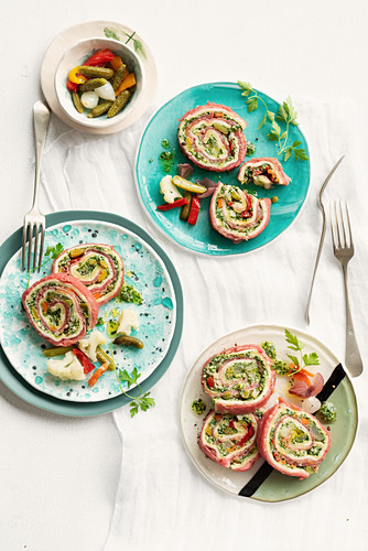 Carpaccio roulade with pickled vegetables and salsa verde