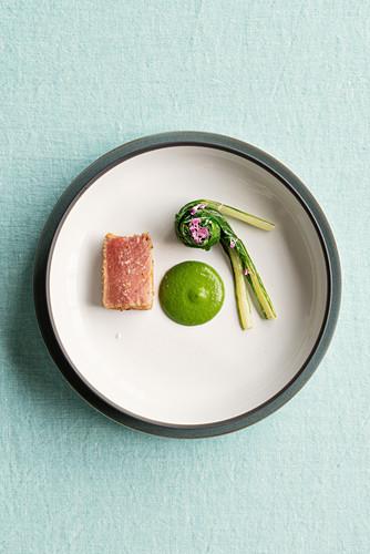 Tuna coated in bread crumbs and ham with chard rolls and mango wasabi cream