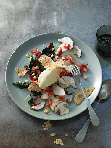 Raw porcini mushrooms with olive oil ice cream on mango salad