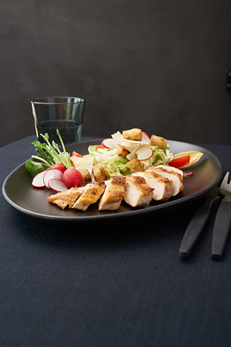 Caesar salad with grilled corn-fed chicken breast