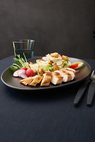 Caesar salad with grilled corn chicken breast