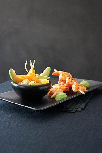 Grilled prawn skewesr with avocado cream and couscous salad