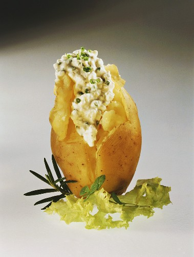 A potato cooked in its skin, with chive quark