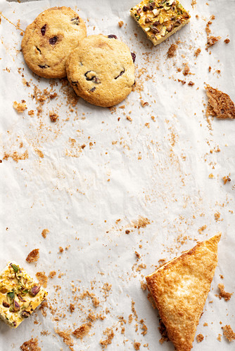 An arrangement of cranberry and peanut cookies, blondies with pistachios and apple turnovers