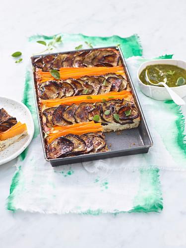 Aubergine tian with ricotta, carrots and oregano and parsley pesto