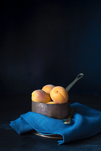 Apricots in a saucepan