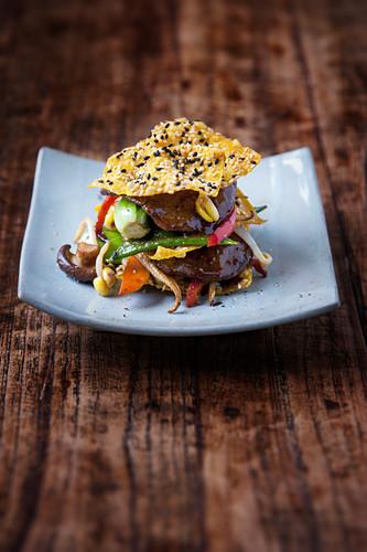 Beef teriyaki with stir-fried vegetables and sesame seed crisps