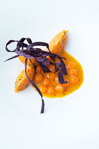 Carrot soup with carrot balls and fried carrots