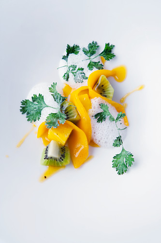Exotic fruit with coconut foam and crispy coriander leaves