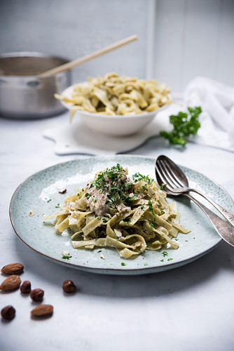 Vegan spinach tagliatelle with a hazelnut and almond sauce