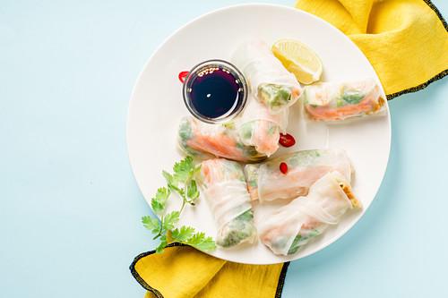 Vegan spring rolls with tofu, marinated carrot and daikon