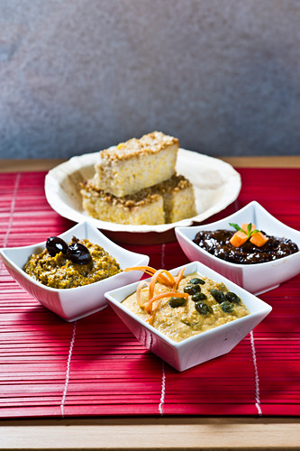Olive spread, dried fruit spread, and carrot and tahini spread