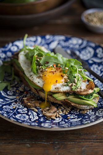 Toast with avocado, egg and greens