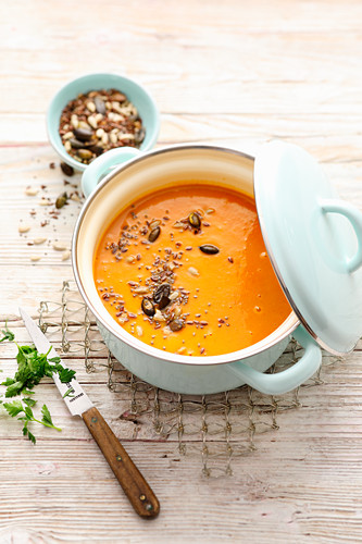 Autumn pumpkin soup with apple, ginger and seeds