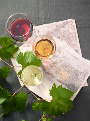 Red wine, white wine and passito in glasses