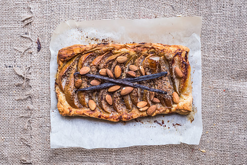 Rustic pear square galette with almond and vanilla over a sackcloth background