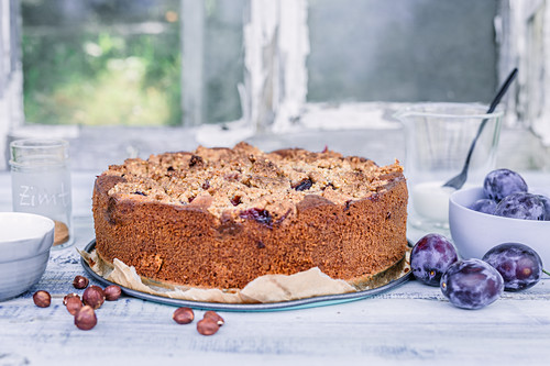 Plum cake with vanilla, and hazelnut crumbles