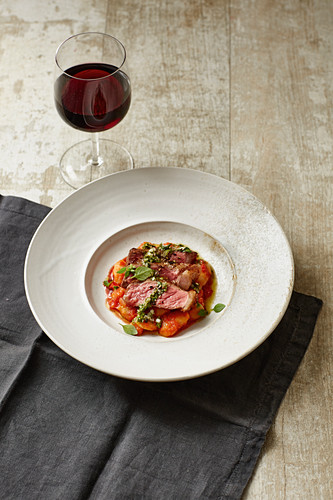 Grilled chimichurri steak with cannellini beans