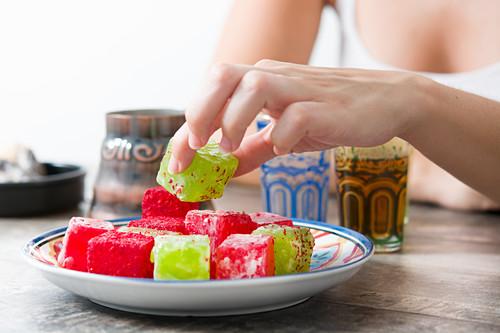 Woman picking turkish sweets