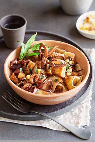 Pappardelle with red wine octopus, pears, breadcrumbs and pecorino