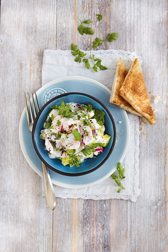 Avocado and prawn salad with buttered toast