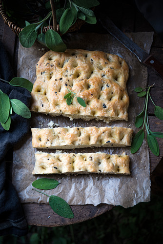 Vegan focaccia with sage and olives (seen from above)