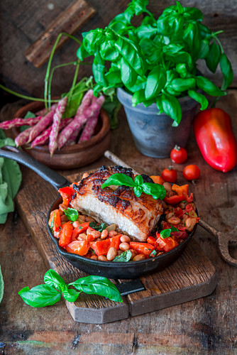 Roast pork with beans and vegetables