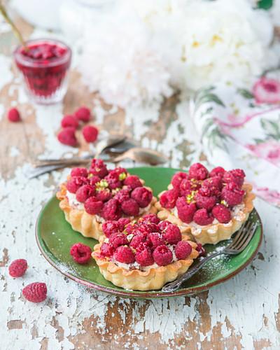 Raspberry and pistachio tarts
