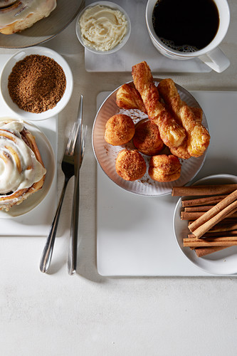 Cinnamon roll and pastries with coffee