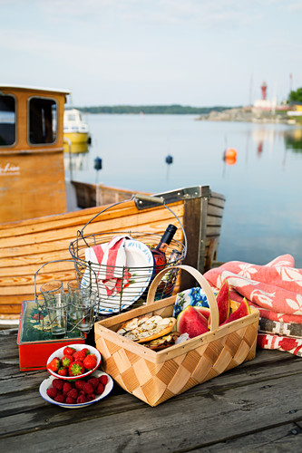 Mini potato pizzas and fruit for a picnic on a jetty
