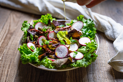 Salad drizzled with olive oil