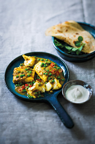 Coconut fish and pea curry