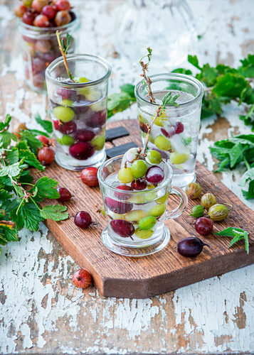 Gooseberry popsicles in water as a summer drink