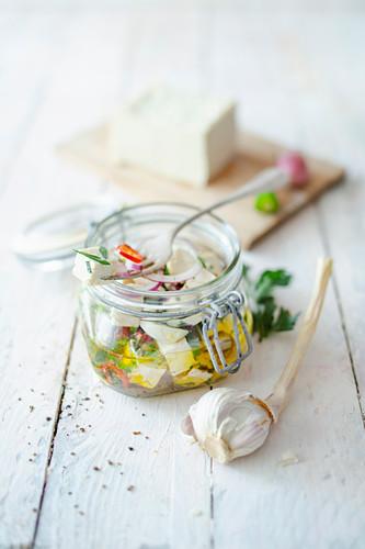 Preserved vegan feta with peperoni and garlic