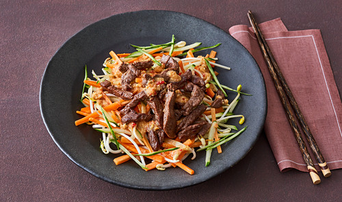 Vietnamese beef with a vegetable salad and peanut sauce