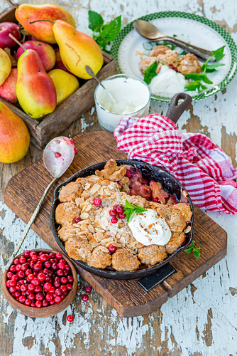 Pear and apple cobbler with cranberries