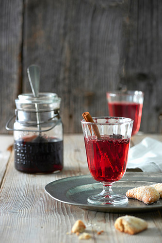 Red wine punch and Christmas biscuits on a metal plate
