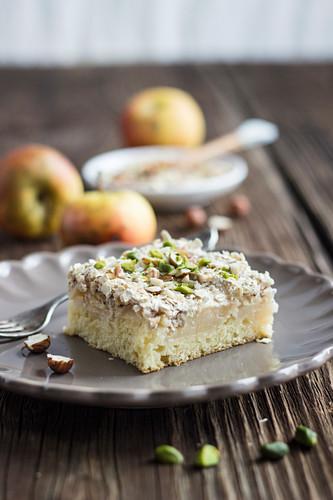 A slice of apple meringue tray bake cake