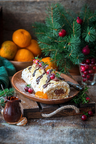 Meringue roll with clementine curd and chocolate