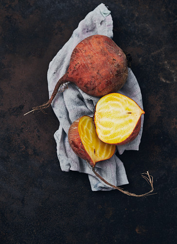 Yellow beets, sliced on a cloth