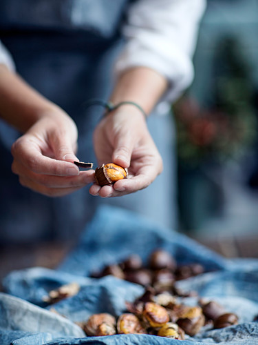 Hot chestnuts being peeled