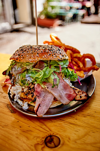 Chicken burger with bacon and chips
