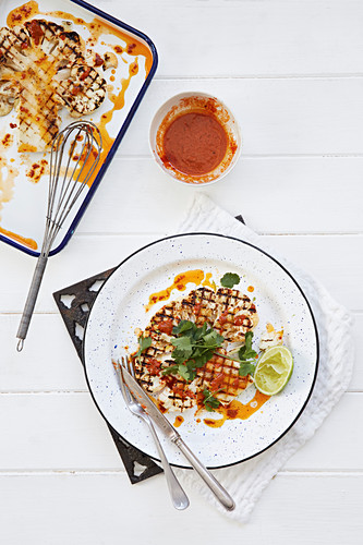 Barbecued Cauliflower with dipping sauce, coriander and lime