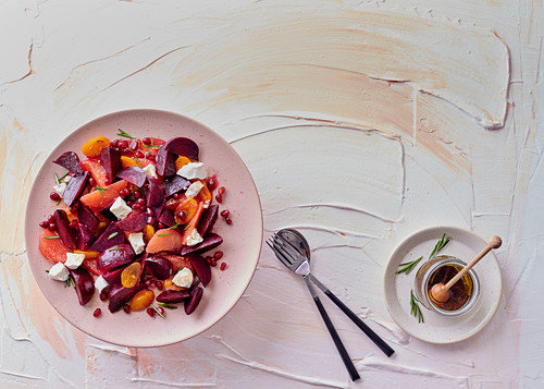 Beetroot, grapefruit, tomato and goat's cheese salad with warm honey dressing