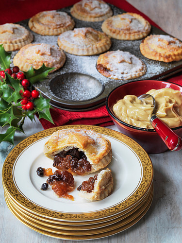 Christmas mince pies being served with brandy butter