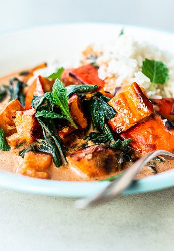 Pumpkin curry with spinach, close up