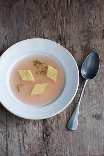 Clear apple soup with polenta slices