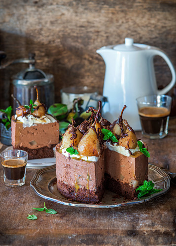 No bake chocolate cheesecake with poached pears and chocolate mousse sponge